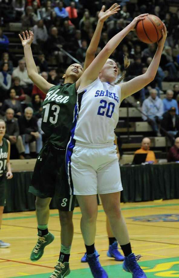 Shenendehowa's Sydney Quinn, left, and Shaker's Sage VanAmerongen go up for a rebound during the Class AA girls' basketball semifinal at Hudson Valley Community College on Thursday, Feb. 27, 2014 in Troy, N.Y.  (Lori Van Buren / Times Union) Photo: Lori Van Buren / 00025933A