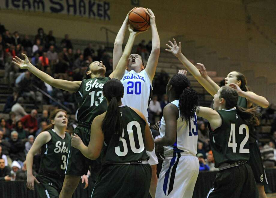 Shenendehowa's Sydney Quinn and Shaker's Sage VanAmerongen battle for the ball during the Class AA girls' basketball semifinal at Hudson Valley Community College on Thursday, Feb. 27, 2014 in Troy, N.Y.  (Lori Van Buren / Times Union) Photo: Lori Van Buren / 00025933A