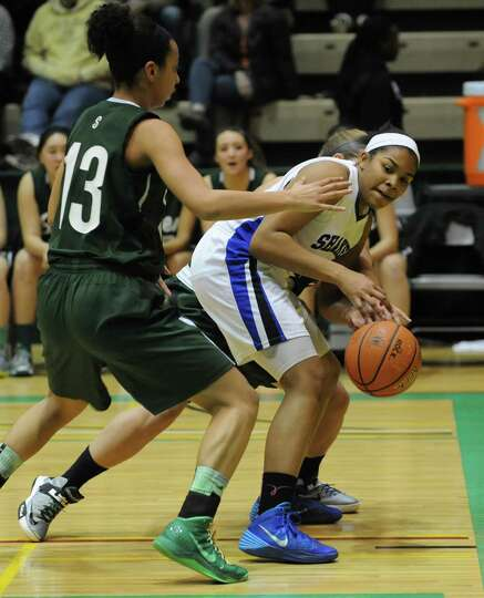 Shaker's Lyric Artis, right,  is guarded by Shenendehowa's Sydney Brown during the Class AA girls' b