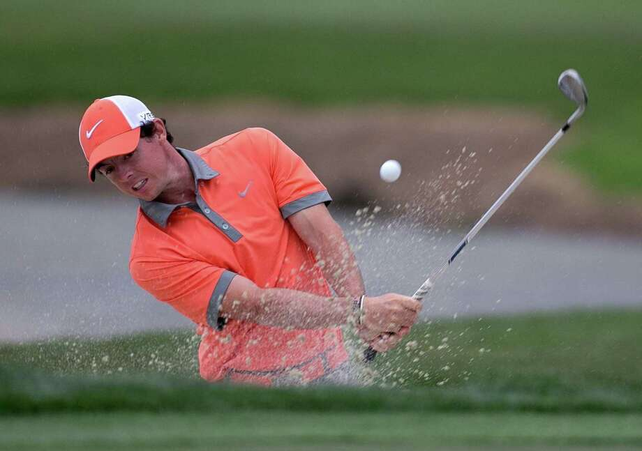 Not even landing in a bunker on No. 18 could keep Rory McIlroy from shooting a 7-under 63 and leading the Honda Classic after the first round. Photo: ALLEN EYESTONE, MBR / Palm Beach Post