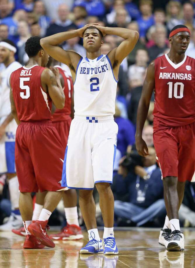 Kentucky's Aaron Harrison reacts to a foul call. Arkansas made 16 of 16 free throws, including six during overtime. Photo: Andy Lyons / Getty Images / 2014 Getty Images