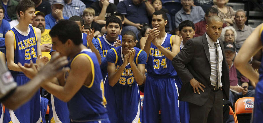 Coach Cliff Ellis (far right) has Clemens just two wins away from securing the school's first berth to the state tournament. Photo: Kin Man Hui, San Antonio Express-News / ©2013 San Antonio Express-News