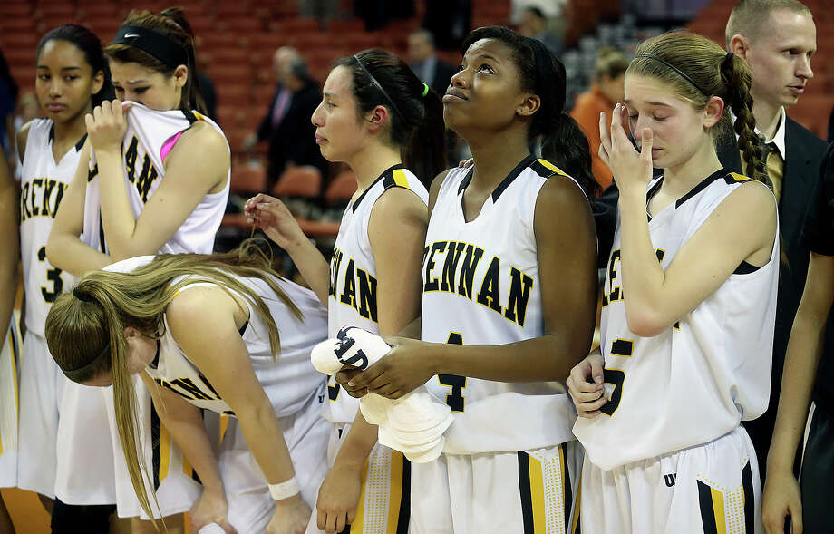 Players stand stunned as Brennan loses to McKinney North in the semifinals of the state 4A basketball tournament at the Erwin Center in Austin  on February 27, 2014. Photo: For The San Antonio Express-News
