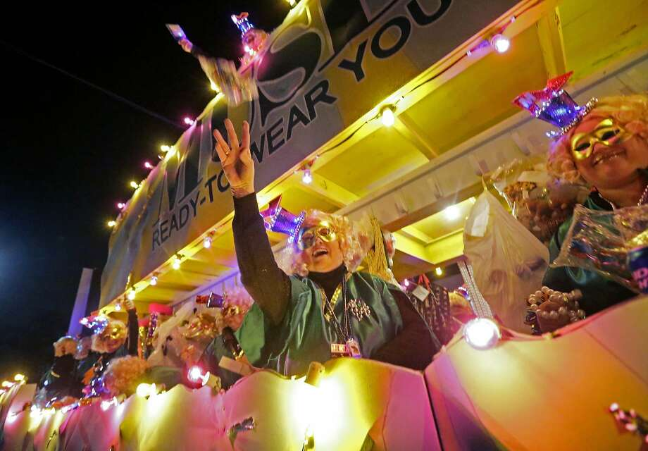 Krewe members throw beads from floats during the Krewe of Muses Mardi Gras parade in New Orleans, Thursday, Feb. 27, 2014. (AP Photo/Gerald Herbert) Photo: Gerald Herbert, Associated Press