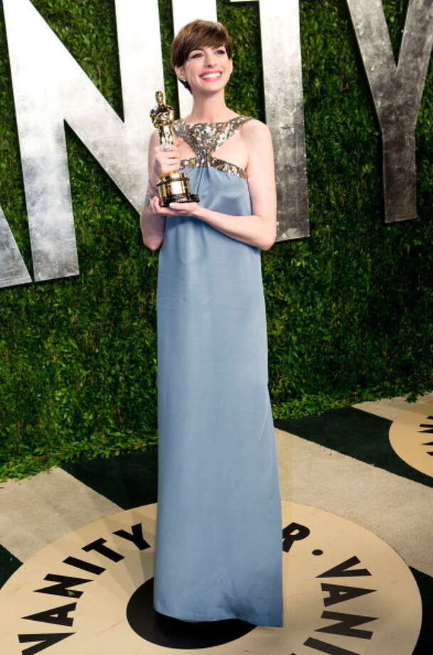 In fairness to ANNE HATHAWAY, she could easily have been nominated for BROKEBACK MOUNTAIN or ONE DAY.  But her Oscar in LES MISERABLES, for essentially wrecking the one good song in LES MISERABLES, has to stand as one of the worst Oscar choices of this generation. Photo: ADRIAN SANCHEZ-GONZALEZ, AFP/Getty Images / 2013 AFP