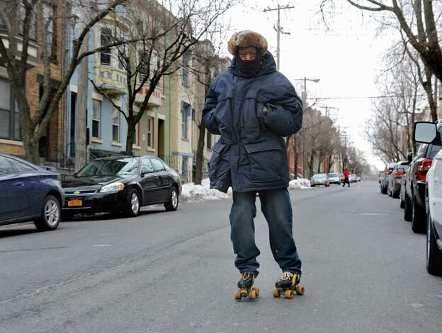 Abdul Nur of Albany roller-skates in front of his Grand St. home Thursday afternoon, Feb. 27, 2014, in Albany, N.Y.  (Lori Van Buren / Times Union) Photo: Lori Van Buren / 00025939A