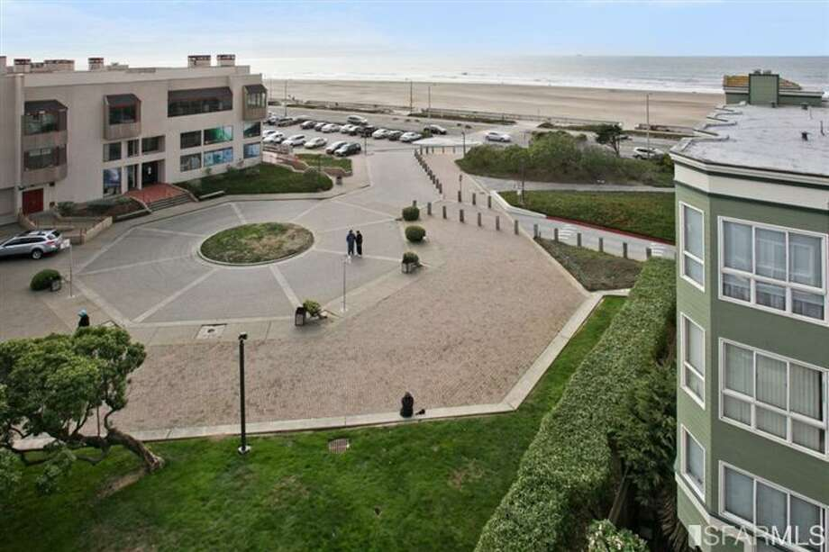 Courtyard and sea. MLS/John Kirkpatrick, TRI Coldwell Banker