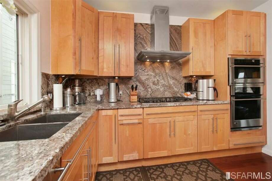 Closer view of kitchen. MLS/John Kirkpatrick, TRI Coldwell Banker