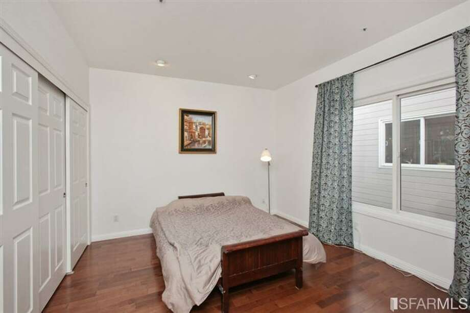 Another bedroom, this one plainer. A lot plainer. MLS/John Kirkpatrick, TRI Coldwell Banker