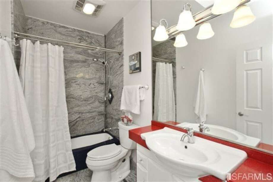 Another bath, this one with intense primary color accents MLS/John Kirkpatrick, TRI Coldwell Banker