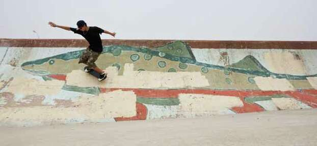 Chris Flores, 16, of Luling, Texas, tries a skateboard trick on a beach ramp March 13, 2012, on the beach by Seawall Boulevard in Galveston. Flores is spending the week in Galveston with his family for spring break. Photo: Nick De La Torre, Houston Chronicle / © 2012  Houston Chronicle