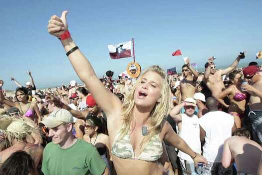 Amanda Delaney yells out from the crowd as she and other spring breakers enjoy the music coming from the the Full Throttle Energy Spring Break stage during Texas Week in South Padre Island on March 14, 2008. Photo: Billy Smith II, Houston Chronicle / Houston Chronicle