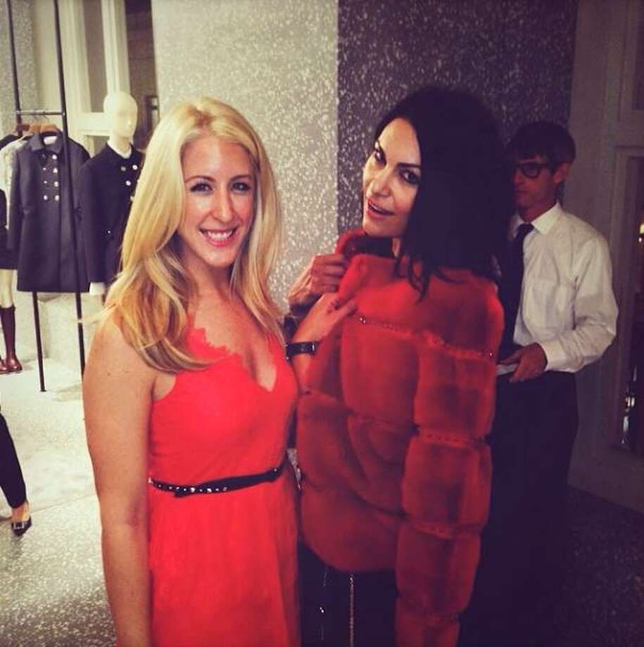 Red fur alert on the fourth floor! Cristin Zweig of Trulia (at left) and Facebook's Libby Leffler have a little fun at the Valentino opening.