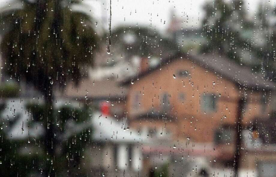 A steady downpour of rain fell over Oakland  and the Bay Area on Friday morning. Photo: SF Gate / Douglas Zimmerman
