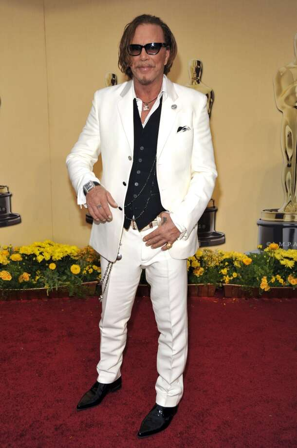 If any man dares to dress in anything but black, drink!What's in for men is basic black, but when someone changes it up, it's worth a toast. Drink up in the name of color—or all white. We can always count on Mickey Rourke. Photo: Kevin Mazur, WireImage