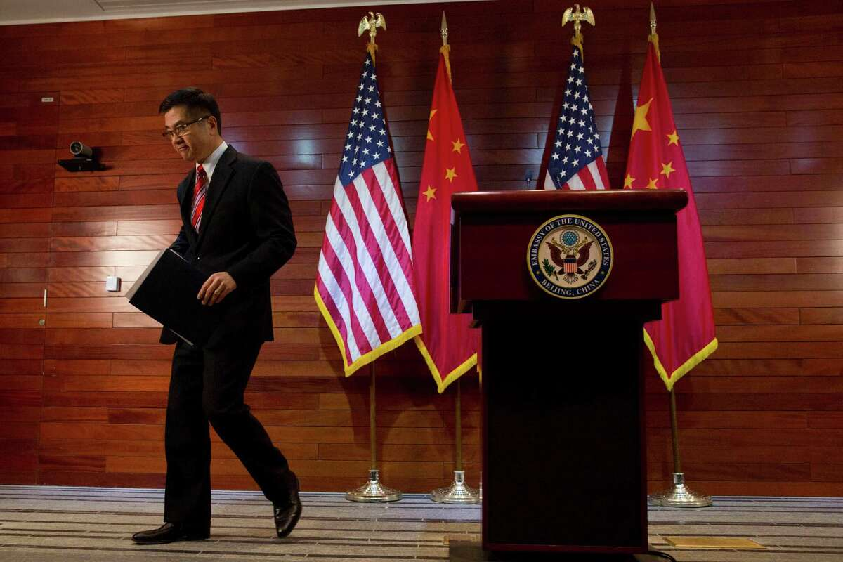In this Thursday, Feb. 27, 2014, file photo, Gary Locke, the outgoing U.S. ambassador to China, leaves after a farewell news conference held at the U.S. Embassy in Beijing. A major Chinese government news service used a racist slur to describe Locke in a mean-spirited editorial on Friday that drew widespread public condemnation in China.