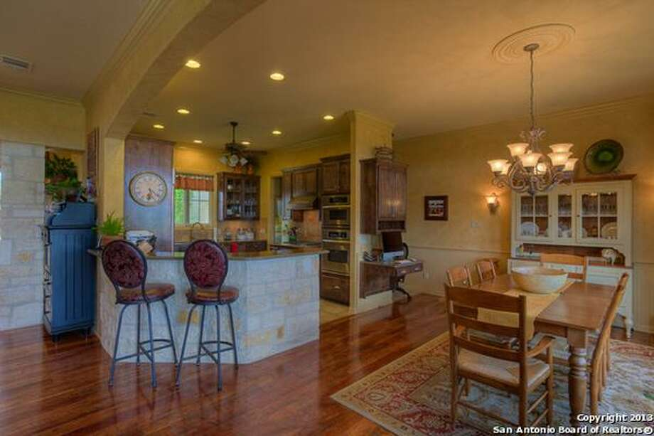 Picturesque hill country style home san antonio express news Hill country wood flooring