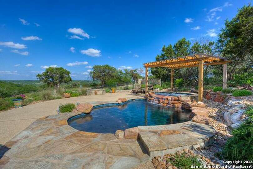 This Beautiful Landscaped Stone Stucco Home Features