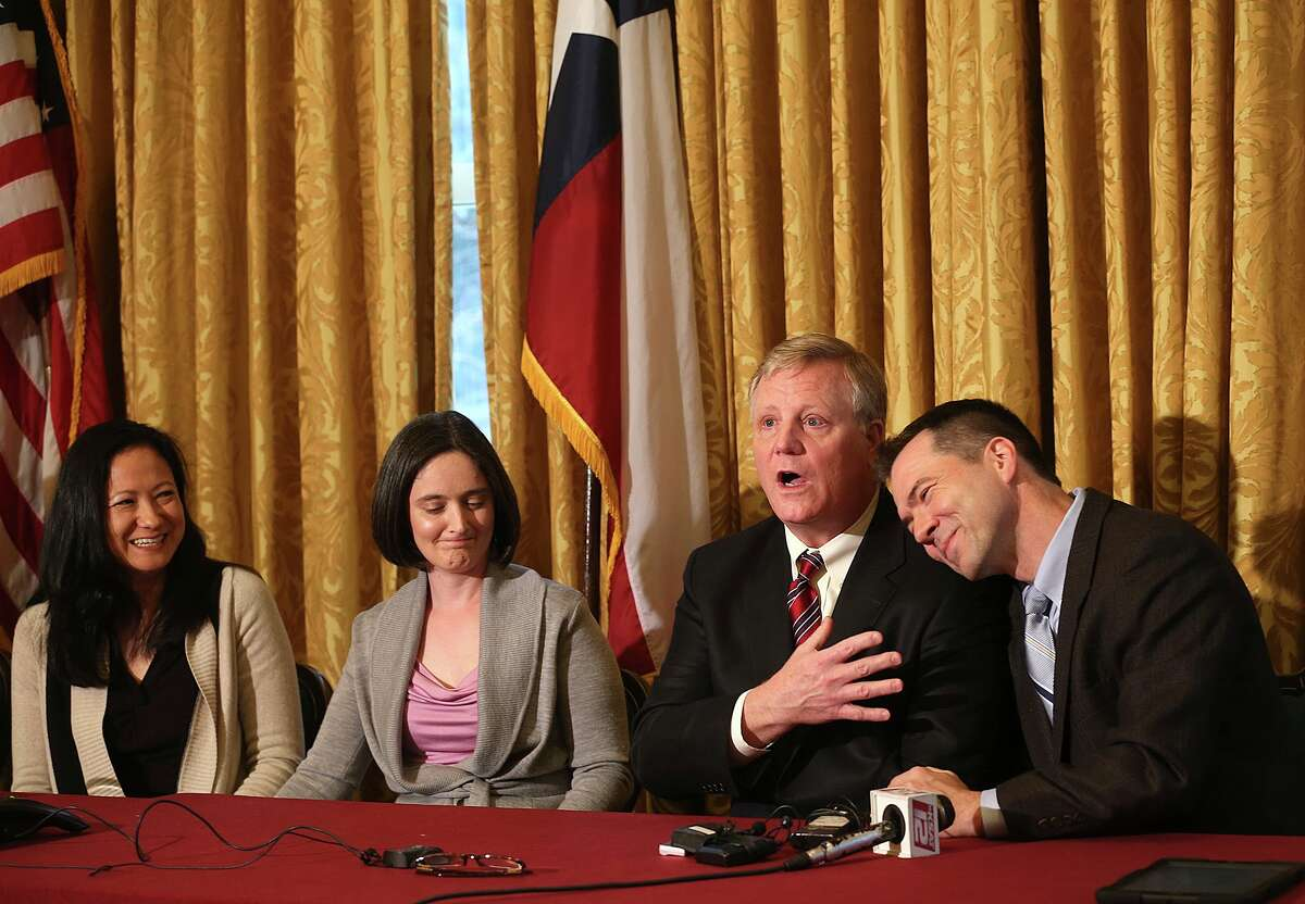 Gay couples from left, Cleopatra De Leon and Nicole Dimetman, and Mark Phariss and Victor Holmes, give a news conference in San Antonio on Wednesday, Feb. 26, 2014 after U.S. Federal Judge Orlando Garcia declared a same-sex marriage ban in deeply conservative Texas unconstitutional.