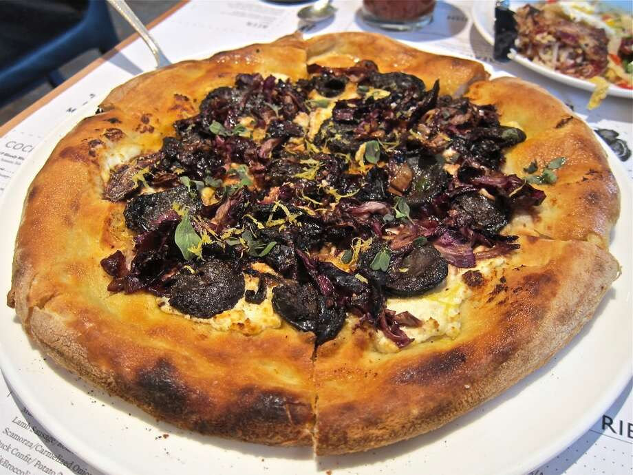 The morcilla pizza at Provisions is a good starting point for someone who has never tried blood sausage before. Keep clicking to see other offerings from the popular restaurant. Photo: Alison Cook