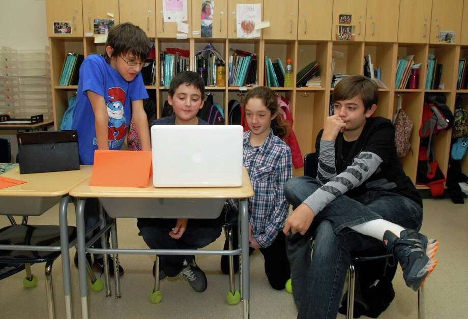 Glenville School's fifth-graders Thomas Nonkovic, Vinny Fama, Delaney Roth and Nicholas Troy watch Vinny's astronomy class presentation on Friday February 28, 2014 in Greenwich, Conn. Photo: Dru Nadler / Stamford Advocate Freelance