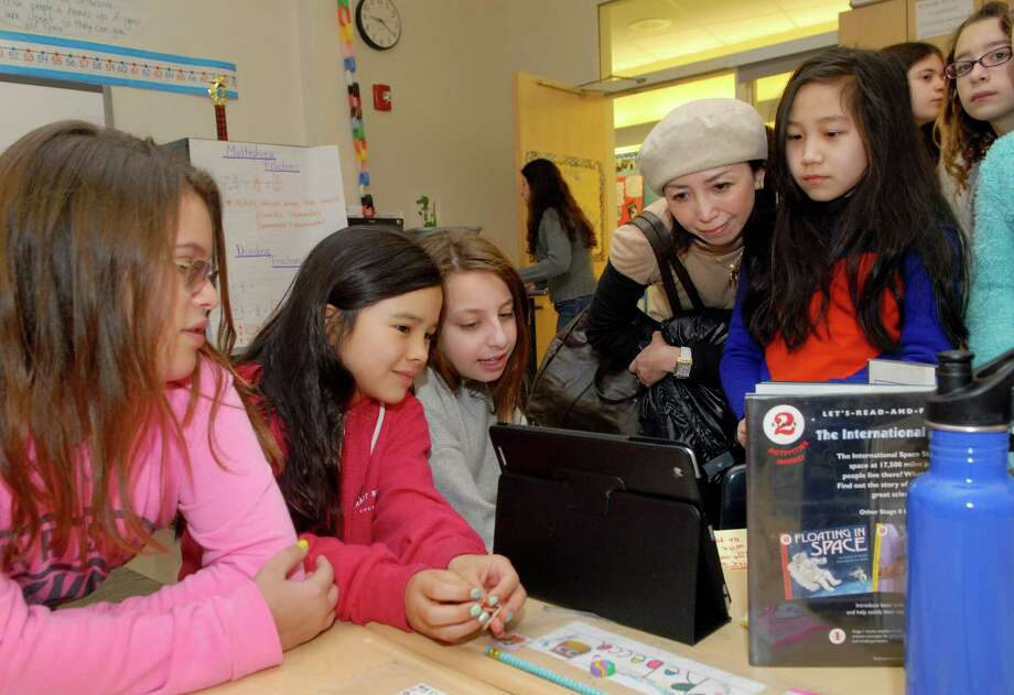 Glenville School's fifth-graders make their astronomy class presentations on Friday February 28, 2014 to parents and other students in Greenwich, Conn. Photo: Dru Nadler / Stamford Advocate Freelance