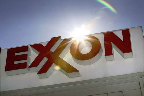 FILE - This Oct. 26, 2006, file photo, shows an Exxon logo seen at a Dallas gas station. Exxon Mobil's annual long-term energy outlook, released Thursday, Dec. 12, 2013, predicts world energy demand will grow 35 percent by 2040 as electricity and modern fuels are brought to some of the billions of people in the developing world who currently live without power or burn wood or other biomass for cooking and heating. (AP Photo/LM Otero, File) ORG XMIT: NYSB501