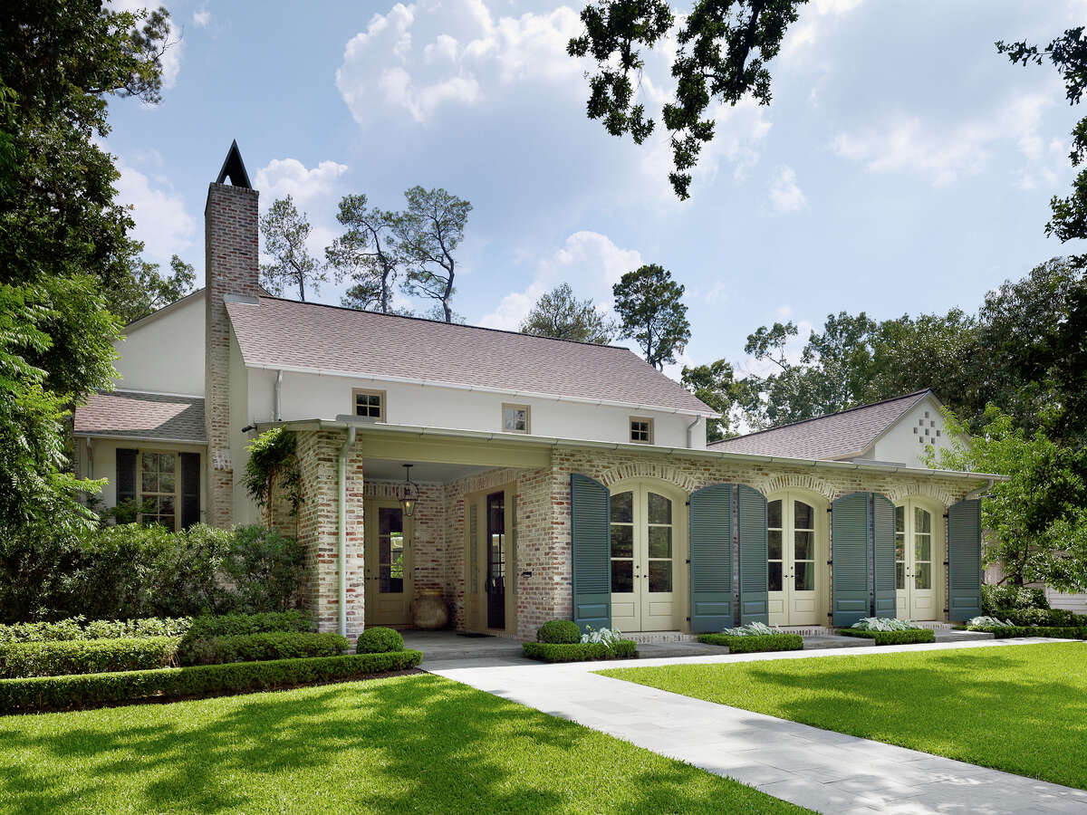 The inviting home design blends elements of Acadian, Spanish and plantation architecture.