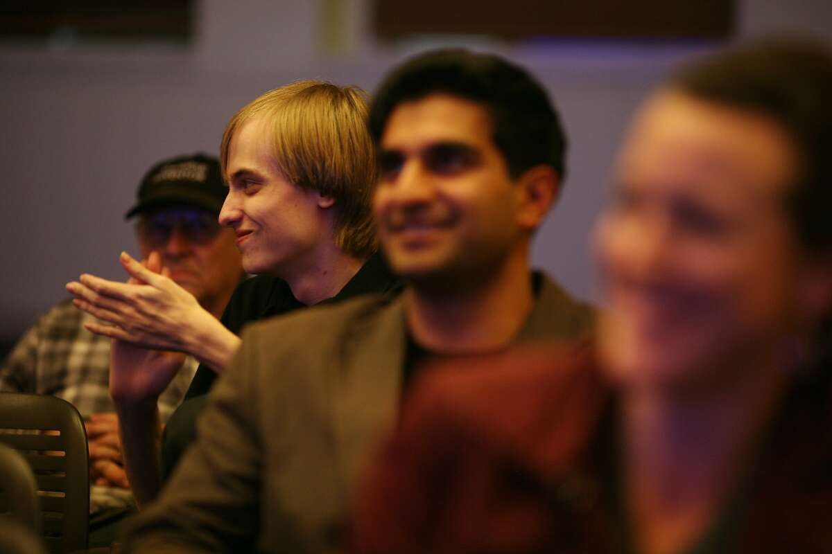 Julian Bliss, second from left, applauds after a poem is read at the Code Poetry Slam at Stanford University in Palo Alto, Calif on Thursday, Feb. 27, 2014. Poems written in code were submitted from around the world.