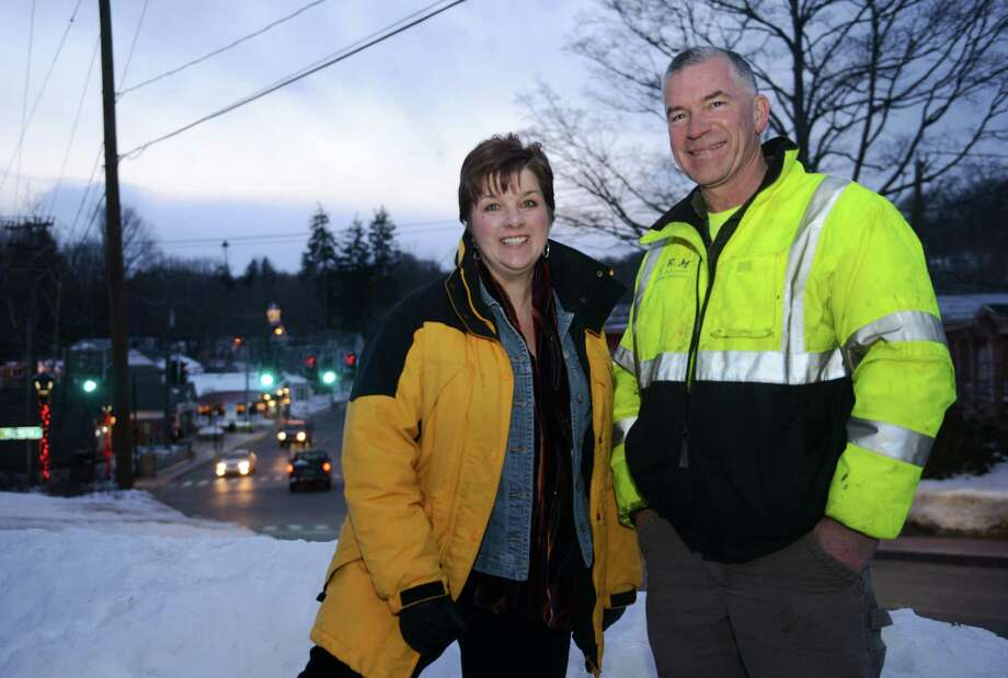"Kimberly Parsons-Whitaker, Associate Director at CT Main Street Center, and Michael Burton, President of Sandy Hook Organization for Prosperity, pose for a photo overlooking Church Hill Road in Sandy Hook, Conn. Thursday, Feb. 27, 2014.  The CT Main Street Center is branding and marketing the Sandy Hook business district with the slogan ""Sandy Hook Village - A place within us all."" Photo: Tyler Sizemore / The News-Times"