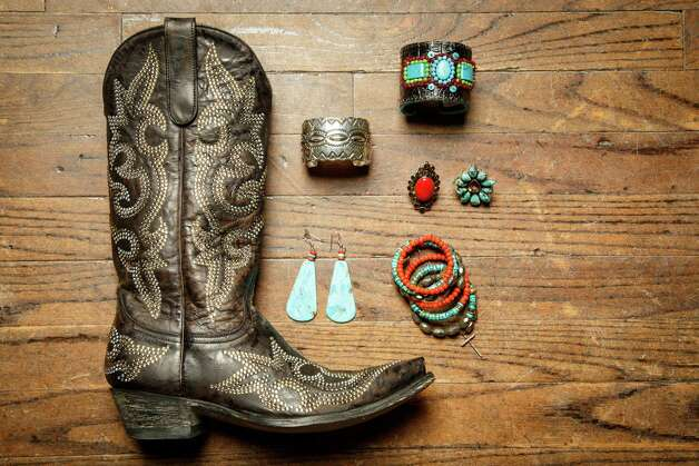 «Old Gringo Swarvoski crystal cowboy boots, $1895, with turquoise earrings, $138; sterling silver cuffs, $730; Laurence DuSauex cuff, $275; Rhed Lion ring, $278; multi-bead bracelet, $365. All from Pinto Ranch. Photo: Michael Paulsen, Staff / © 2014 Houston Chronicle