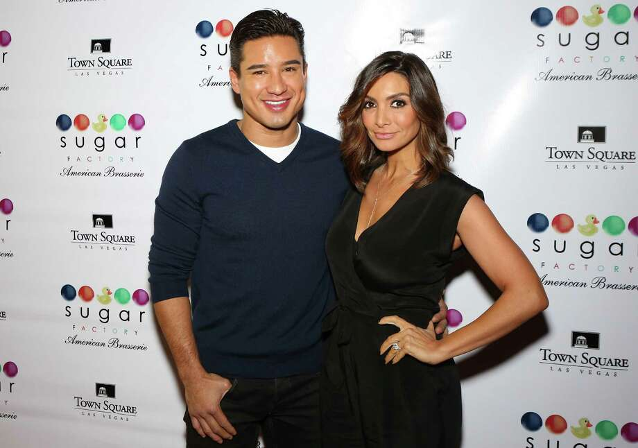 2013: Mario Lopez and wife Courtney Mazza at an event in Las Vegas. Today, Lopez has the highest profile of all the actors from the series, known particularly as a television host. Photo: Gabe Ginsberg, Getty Images / 2013 Gabe Ginsberg