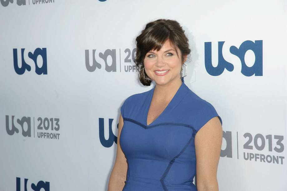 2013: Tiffani Thiessen attends an event in New York. She's dropped the Amber and now has a three-year-old daughter. Photo: Dave Kotinsky, Getty Images / 2013 Getty Images