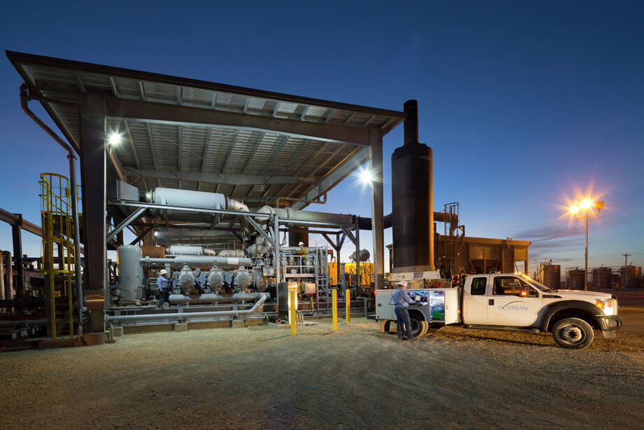 Exterran Partners has agreed to buy hundreds of midstream compressor units, like the one shown here, from Chesapeake Energy for $360 million. These compressor units are typically used to boost pressure to move natural gas from the wellhead to pipelines. Photo: Ken Childress Photography, ©2014 Ken Childress Photography / ©2014 Ken Childress Photography