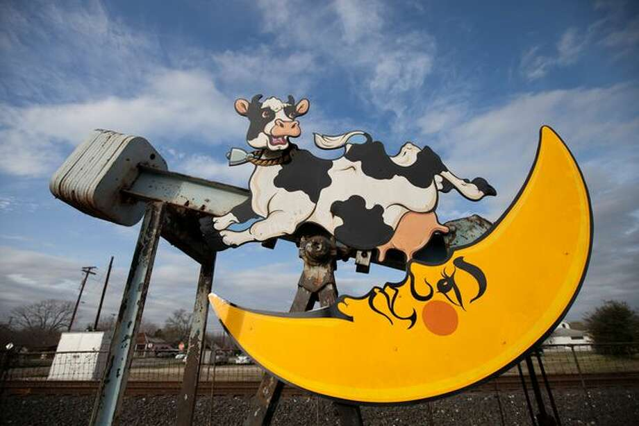"""Luling, which once gushed with oil and was known as the """"toughest town in Texas,"""" has found a unique way to celebrate its heritage: decorating its aging — but still working — pump jacks with vibrant colors and characters.  Above: A few feet away from the train tracks that split Luling, a pump jack showcases a cow jumping over the moon. Photo: Todd Wiseman, TexasTribune.org"""