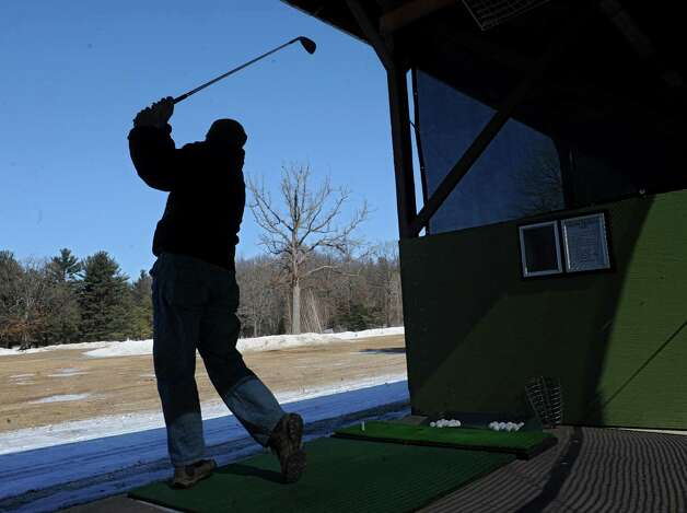 Neil Fitzpatrick of Saratoga Springs works on his swing at the Northway Golf Center off exit 8 on Friday, Feb. 28, 2014, in Halfmoon, N.Y.  (Lori Van Buren / Times Union) Photo: Lori Van Buren / 00025957A