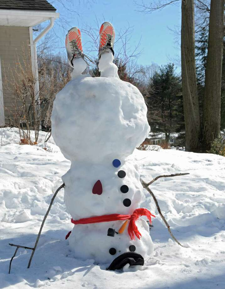 Even this snowman is fed up with all this snow on Friday, Feb. 28, 2014, on Southbury Rd. in Halfmoon, N.Y.  (Lori Van Buren / Times Union) Photo: Lori Van Buren / 00025957A