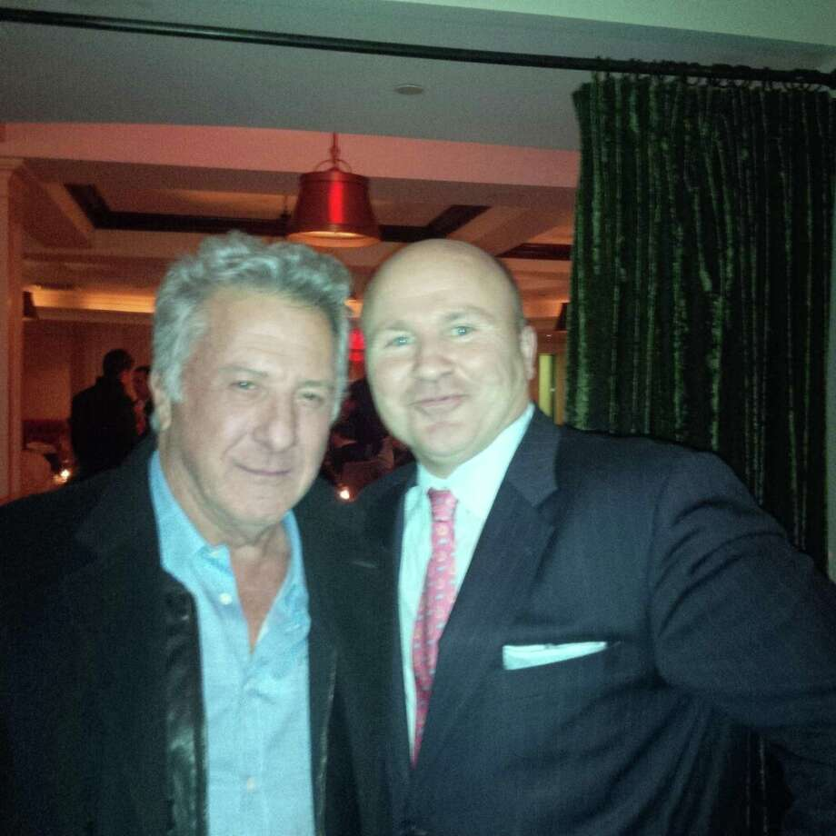 "Actor Dustin Hoffman, left, took time out from filming the movie, ""Boychoir,"" in Fairfield on Thursday to have dinner at Gabriele's Italian Steak House in Greenwich. He was warmly welcomed there by  maitre d'and managing partner Tony Capasso, right. Photo: Contributed Photo / Greenwich Citizen"