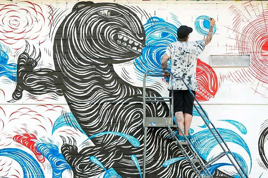 Andrew Schoultz, formerly of San Francisco, paints a tiger mural during Pow Wow Hawaii. The annual festival in Honolulu's industrial district of Kakaako was in February. Photo: Brandon Shigeta