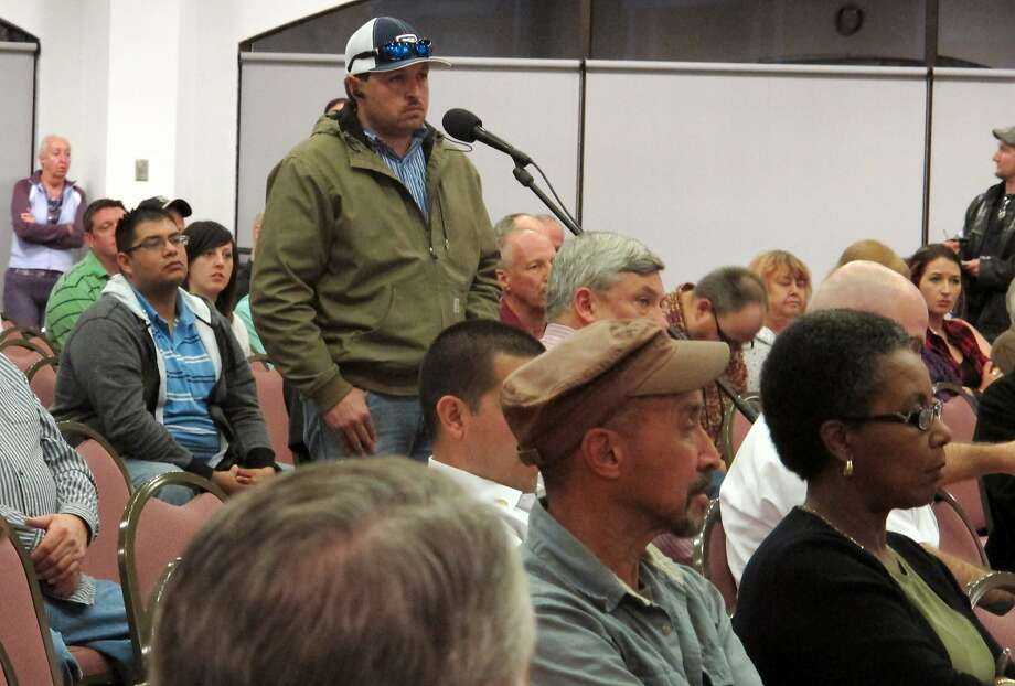 In this Feb. 24, 2014 photo, a member of the community speaks of the Feb. 14, 2014 radiation leak during a community meeting  in Carlsbad, N.M.  New Mexico Sen. Tom Udall says he will ask the Environmental Protection Agency to send air monitors to southeastern New Mexico following a radiation release from the federal government's underground nuclear waste dump near Carlsbad.  Udall says he will send a letter Thursday requesting the portable monitors.  Udall says the health and safety of the community and workers at the Waste Isolation Pilot Plant are his top priority. The EPA has regulatory authority over the site and any airborne radiation releases.  (AP Photo/Jeri Clausing) Photo: Jeri Clausing, Associated Press