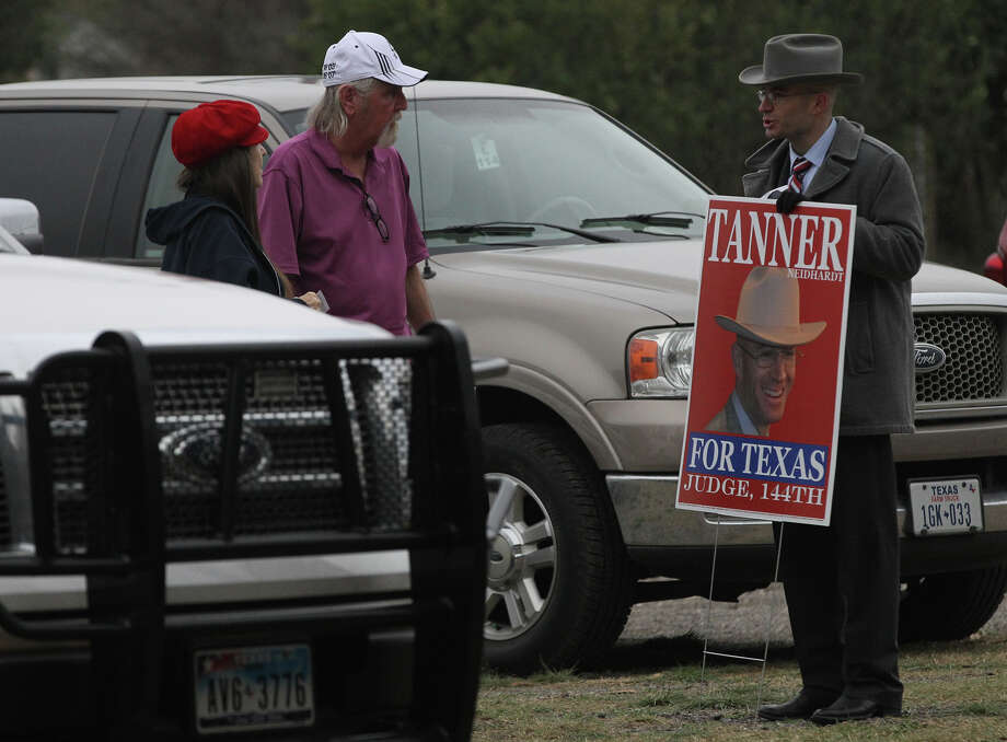 Judicial candidate Tanner Neidhardt (right) speaks Friday February 28, 2014 with people approaching the Brook Hollow Branch of the San Antonio Public Library on the last day of early voting for the March 4 primary. Photo: JOHN DAVENPORT, San Antonio Express-News / ©San Antonio Express-News/Photo may be sold to the public