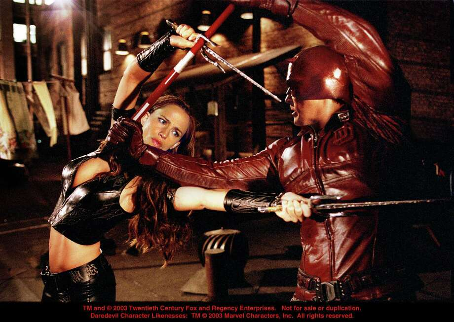 Here, Elektra (Jennifer Garner) grapples with Daredevil (Ben Affleck), unaware that he is Matt Murdock, the man she has fallen in love with in the movie 'Daredevil.' Photo: Zade Rosenthal, 20th Century Fox C2003 / handout