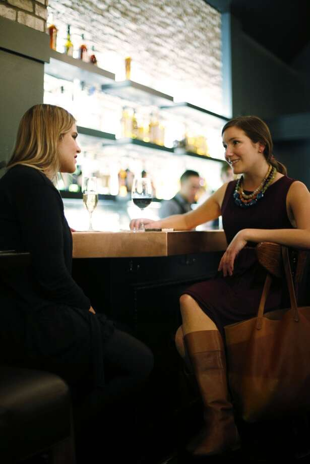 Guests enjoy drinks at The Square in San Francisco. Photo: Carlos Avila Gonzalez, The Chronicle