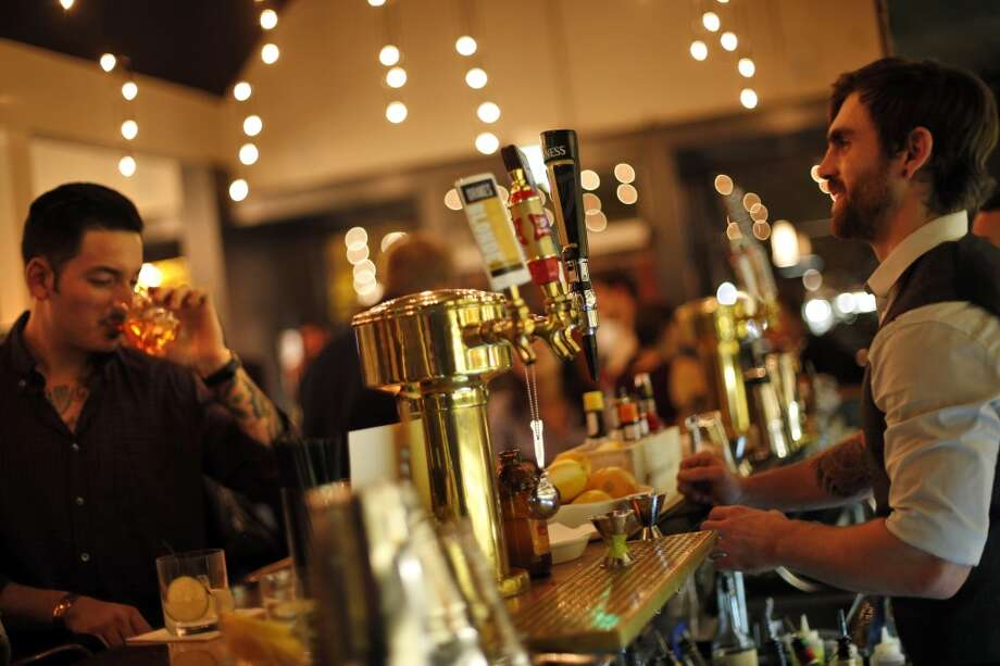 Behind the bar at The Square in San Francisco. Photo: Carlos Avila Gonzalez, The Chronicle