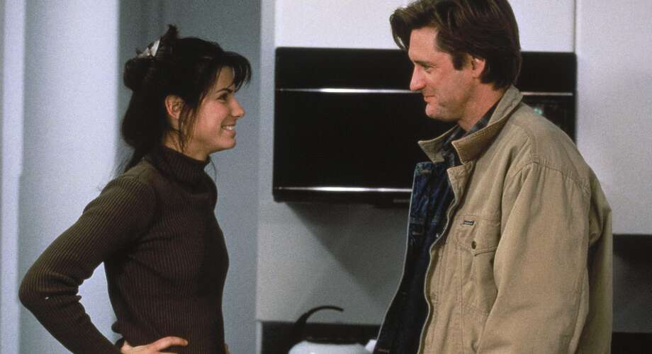 While You Were Sleeping (1995): Sandra Bullock plays a transit worker who pulls a commuter off the tracks after he's mugged. While he's comatose, his family wrongly assumes she's his fiancee and she doesn't correct them ... and then she falls for his brother.