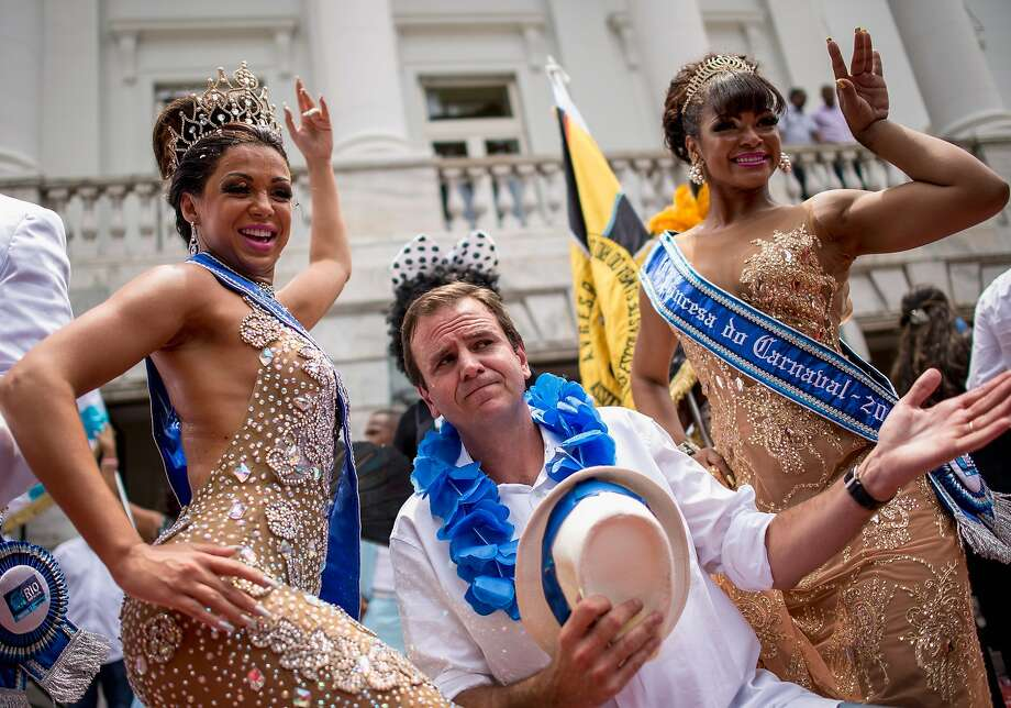 It's good to be mayor:Rio de Janeiro Mayor Eduardo Paes does a song-and-dance routine with the queen (left)   and princess of the city's 2014 Carnival at Cidade Palace. Photo: Buda Mendes, Getty Images