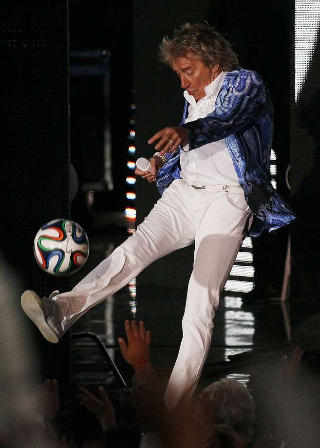 Rocker soccer:Rod Stewart follows the bouncing ball while singing at the Vina del Mar International Song Festival in Vina del Mar, Chile. Photo: Luis Hidalgo, Associated Press