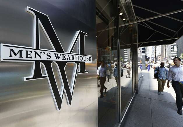 People pass by a Men's Wearhouse store in New York in this file photo takenJune 25, 2013.  Men's Wearhouse Inc raised its offer for Jos. A. Bank Clothiers Inc by over 10 percent, nearly two weeks after its smaller rival looked to fend off the unsolicited bid by agreeing to acquire Eddie Bauer.  REUTERS/Brendan McDermid/Files  (UNITED STATES - Tags: BUSINESS TEXTILE LOGO) Photo: Brendan Mcdermid, Reuters
