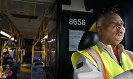 Muni operator Charles Davis, known to many as the singing bus driver, sings the Ulloa stop on the 29 Sunset in San Francisco, Calif.
