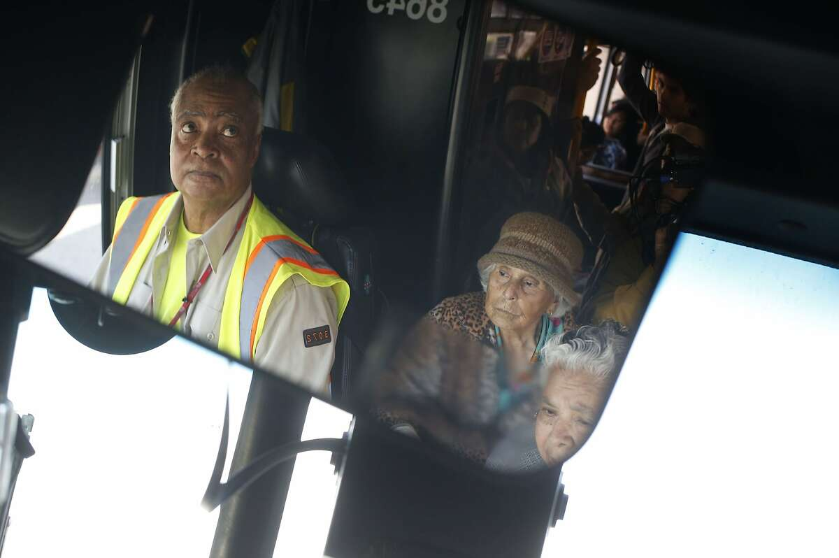 Muni operator Charles Davis keeps and an eye on a crew of 29 Sunset regulars eager to get off at the right stop in San Francisco, Calif.